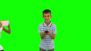 Sister pouring popcorn on brothers head on green screen — Vídeo Stock