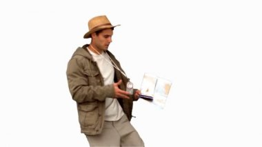 Handsome man orienteering on white screen — Stock Video
