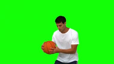 Man dribbling with a basketball on green screen — Stock Video