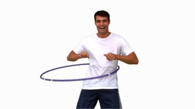 Man playing with a hula hoop on white screen — Stock Video