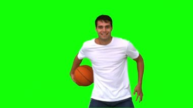 Man playing and dribbling with a basketball on green screen — Stock Video