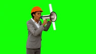 Angry architect using a megaphone on green screen — Stock Video