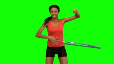 Woman playing with a hula hoop on green screen — Stock Video