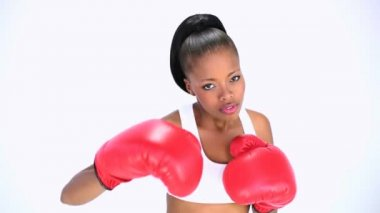 Smiling model wearing red gloves boxing — Video Stock