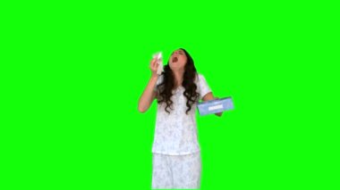 Sick young model in pyjamas sneezing — Stock Video