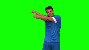 Football player suffering from arm injury on green screen — Stock Video