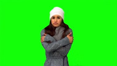 Pretty model in winter clothes shivering — Stock Video