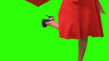 Woman in high heels holding a broken umbrella on green screen — Stock Video