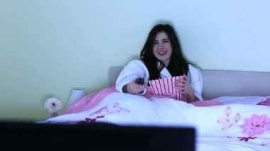 Cheerful young woman watching television — Stock Video