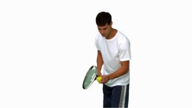Man holding a tennis ball and a racquet on white screen — Stock Video