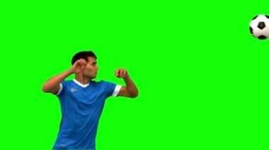 Attractive man heading a football on green screen — Stock Video