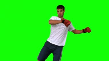 Boxer performing a high kick on green screen — Stock Video