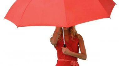 Woman holding an umbrella on white screen — Stock Video