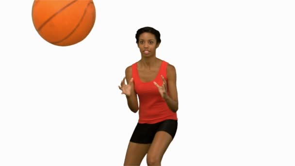 Pretty woman catching and throwing a basketball on white screen — Vidéo