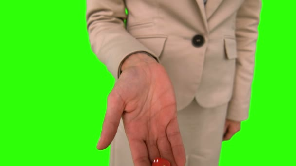 Businesswoman throwing a die on green screen — Vidéo