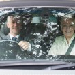 Business people having a ride in classy car — Stock Photo