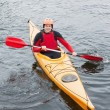 Happy man in a kayak — Stock Photo