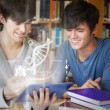 Students using futuristic hologram to learn biology from tablet — Stock Photo