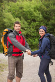 Loving couple going on a hike together holding hands — Stock Photo