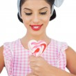 Content black hair model holding a heart shaped lollipop — Stock Photo #31460373