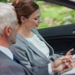 Partners working together in classy car — Stock Photo