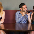 Blonde woman feeling jealous as two people are flirting beside her — Stock Photo #31460781
