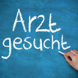 Stock Photo: Hand writing arzt gesucht