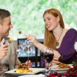 Happy couple eating together — Stock Photo #31461599