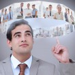 Businessman showing futuristic interface above his head — Stock Photo