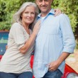 Smiling mature couple posing — Stock Photo