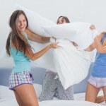 Friends having pillow fight — Stock Photo
