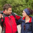 Smiling couple going on a hike together looking at each other — Stock Photo