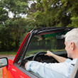 Stock Photo: Handsome mdriving red cabriolet