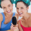 Happy girls in hair rollers holding hairbrush — Stock fotografie #31462579