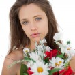 Calm brunette model holding a bouquet of flowers — Foto Stock