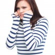 Stock Photo: Apprehensive young brunette posing