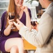Stock Photo: Smiling womhaving glass of wine with her boyfriend