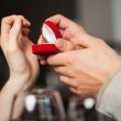 Close up on the ring during marriage proposal — Stock Photo