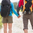 Hikers with backpacks holding hands — Stock fotografie