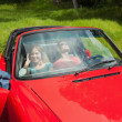 Cheerful young couple relaxing in classy cabriolet — Stock Photo
