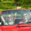 Smiling young couple going for a ride together — Stock Photo