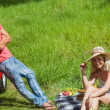 Happy couple having picnic together — Stock Photo