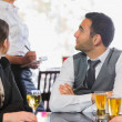 Business people talking to the waiter — Stok fotoğraf