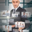 Mature classy businessman using futuristic interface — Stock Photo