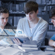 Serious students working on their digital tablet pc — Stock Photo #31463663