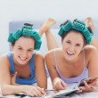 Stock Photo: Girls in hair rollers holding magazines
