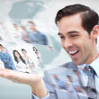 Pleased businessman looking at a picture stream — Stock Photo