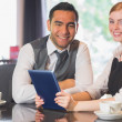 Business team working on tablet pc together in a cafe — Stock Photo #31463767