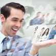Content businessman looking at pictures — Stock Photo