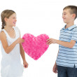 Smiling children holding heart shaped soft toy — Stock Photo